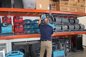 Fire Damage Restoration Long Beach Technician Prepping Air Movers