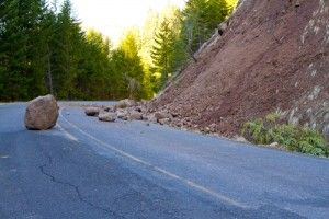 Road Black Due To Falling Boulders