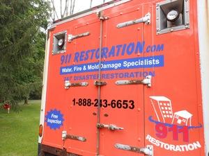 Water Damage Long Beach Box Truck Rear At Residential Job Location