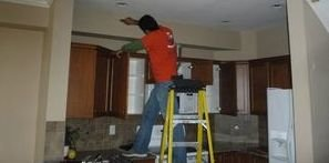 Water Damage Restoration Being Conducted On Ceiling