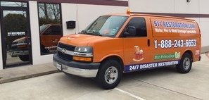 Water Damage and Mold Removal Restoration Van Ready At Commercial Job Site